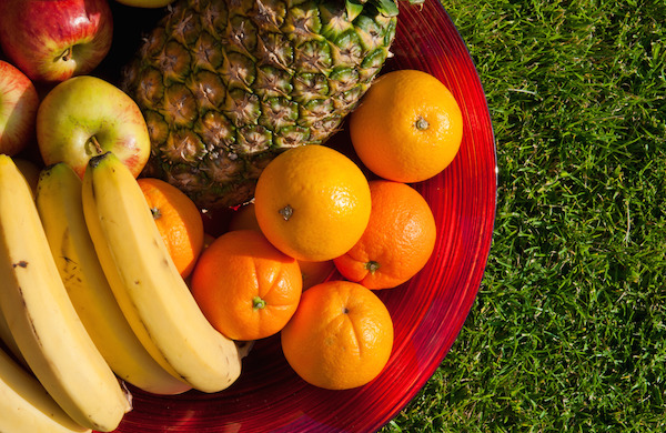 fruit bowl with apples, bananas, oranges and pineapple